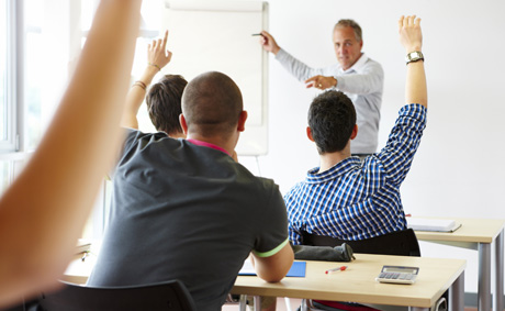 A college teacher in the classroom with his students